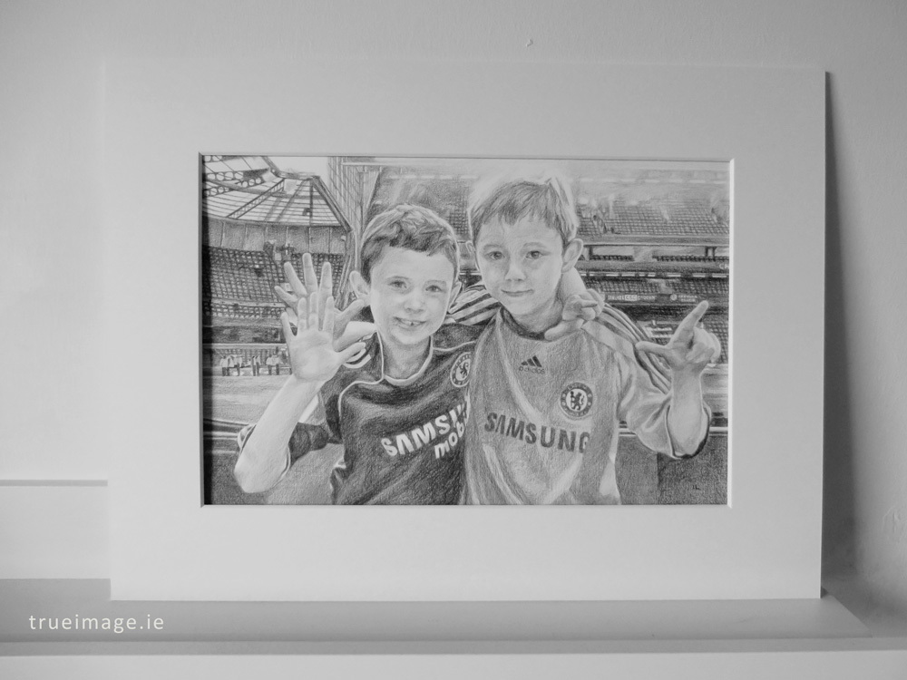 mounted pencil portrait of two boys
